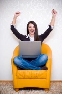 Triumphant woman with laptop