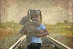 Kindness little girl with a teddy bear