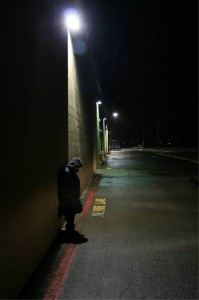 Lonely man in alley