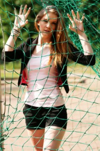 Chearleader at net practice in sunny outdoor